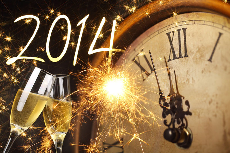 Glasses with champagne against fireworks and clock close to midnight 2014